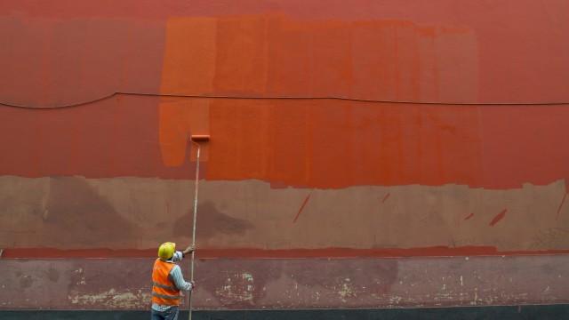 Man painting a wall - fotokunst von Thomas Heinrich