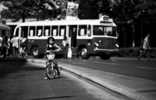 A girl on her bicycle - fotokunst von Nasos Zovoilis