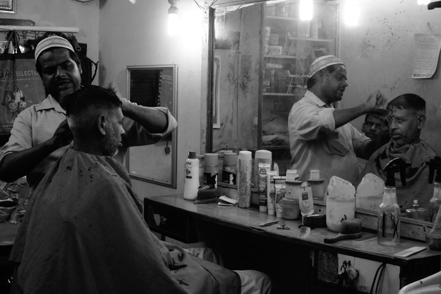 A barber in action  - Fineart photography by Jagdev Singh