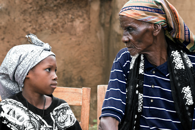 Chief & his grandson of  the village Kumbungu - Fineart photography by Lucía Arias Ballesteros