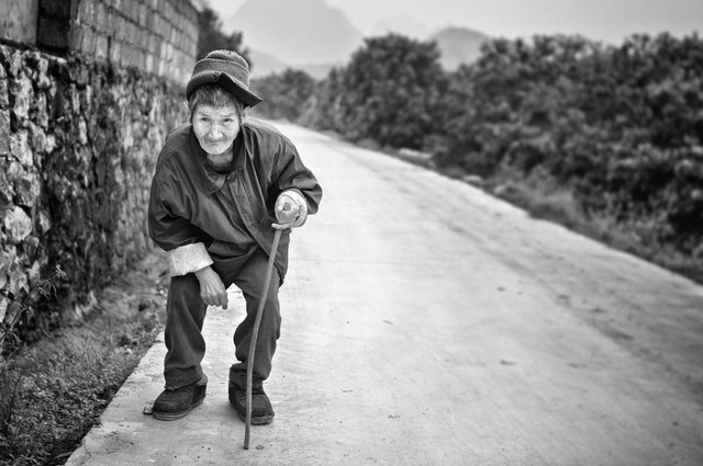An elderly villager - Fineart photography by Victoria Knobloch