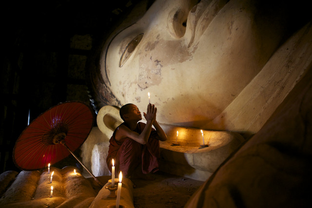 Praying monk in Bagan, Myanmar - Fineart photography by Christina Feldt