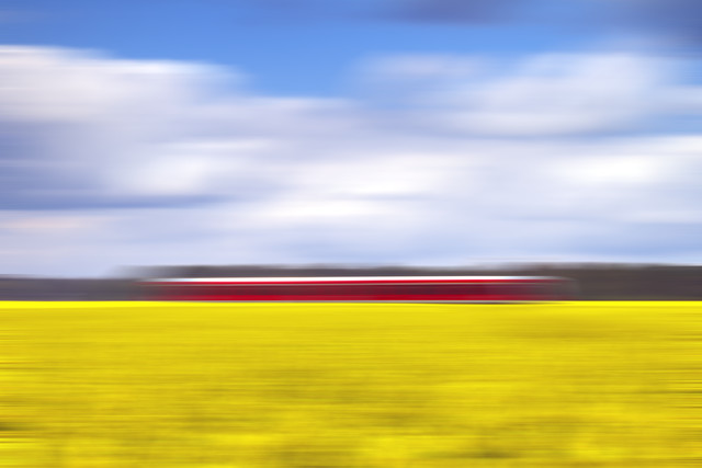 canola & the red train - Fineart photography by Oliver Buchmann