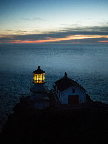lighthouse at dusk - Fineart photography by Leo Thomas