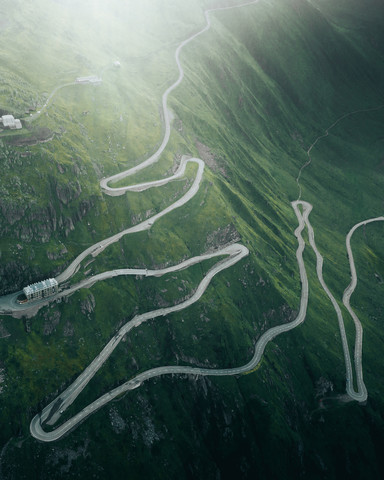 A winding mountain road in Switzerland - Fineart photography by Frederik Schindler