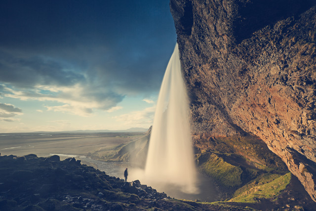 Seljalandsfoss at golden hour with one person - Fineart photography by Franz Sussbauer