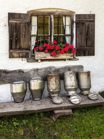 Milk cans on an alp in Bavaria - Fineart photography by Christine Wawra