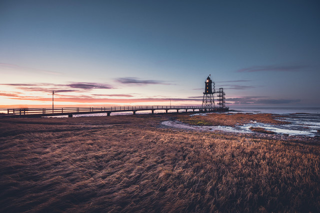 Historical lighthouse Obereversand in the evening light. - Fineart photography by Franz Sussbauer