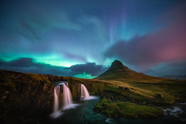 Kirkjufell waterfall and mountain with northern lights - Fineart photography by Franz Sussbauer