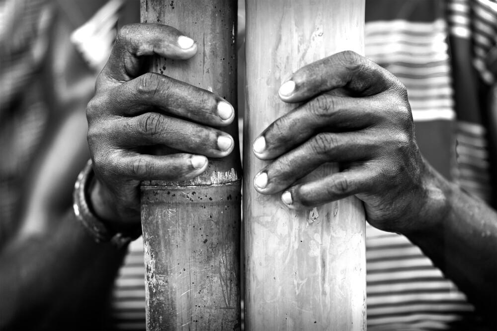 Bamboo player - Assin Mesomagor, Central Region - Fineart photography by Lucía Arias Ballesteros