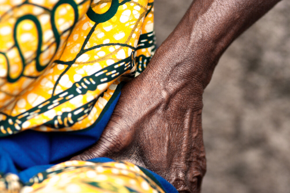 Detail. Woman singing - Asotwe village  - Fineart photography by Lucía Arias Ballesteros