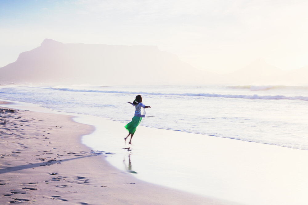 Girl dancing in front of Table Mountain - Fineart photography by Eva Stadler