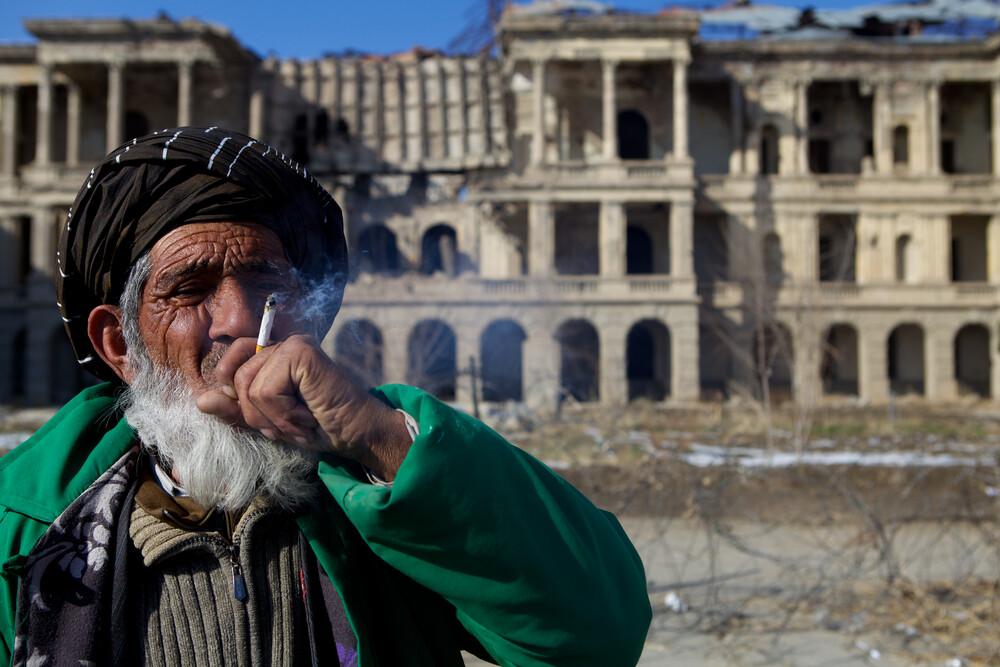 Man at Darul Aman Palace, Kabul - Fineart photography by Christina Feldt