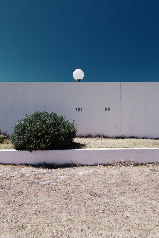 Wall, bush and lamp - Fineart photography by Eva Stadler