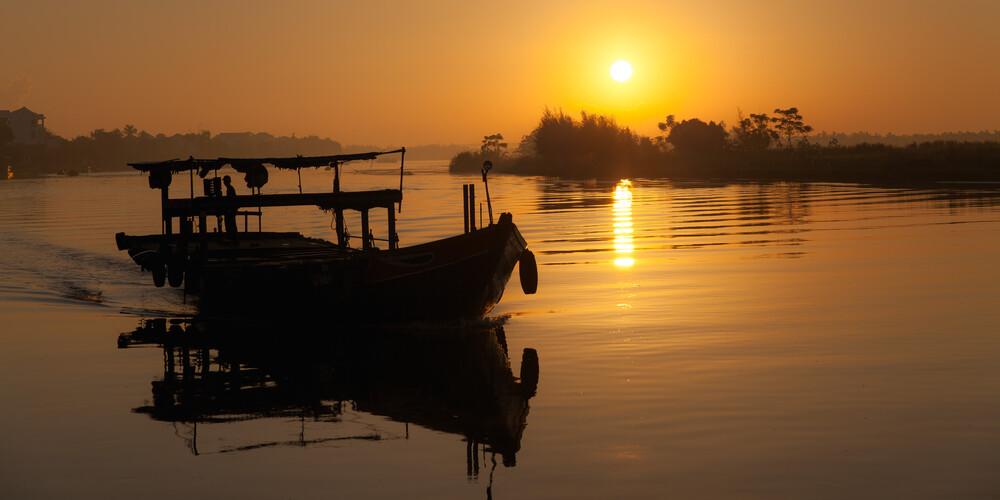 Fishing Boat in Sunrise (Hoi An) - Fineart photography by Jörg Faißt
