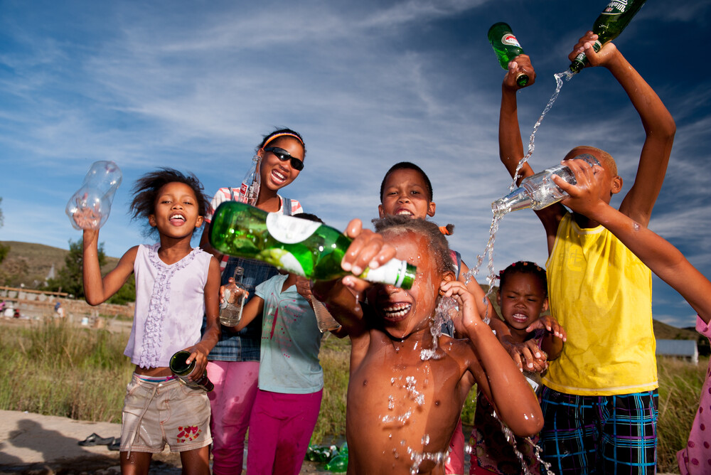 Kids with bottles - Fineart photography by Jac Kritzinger