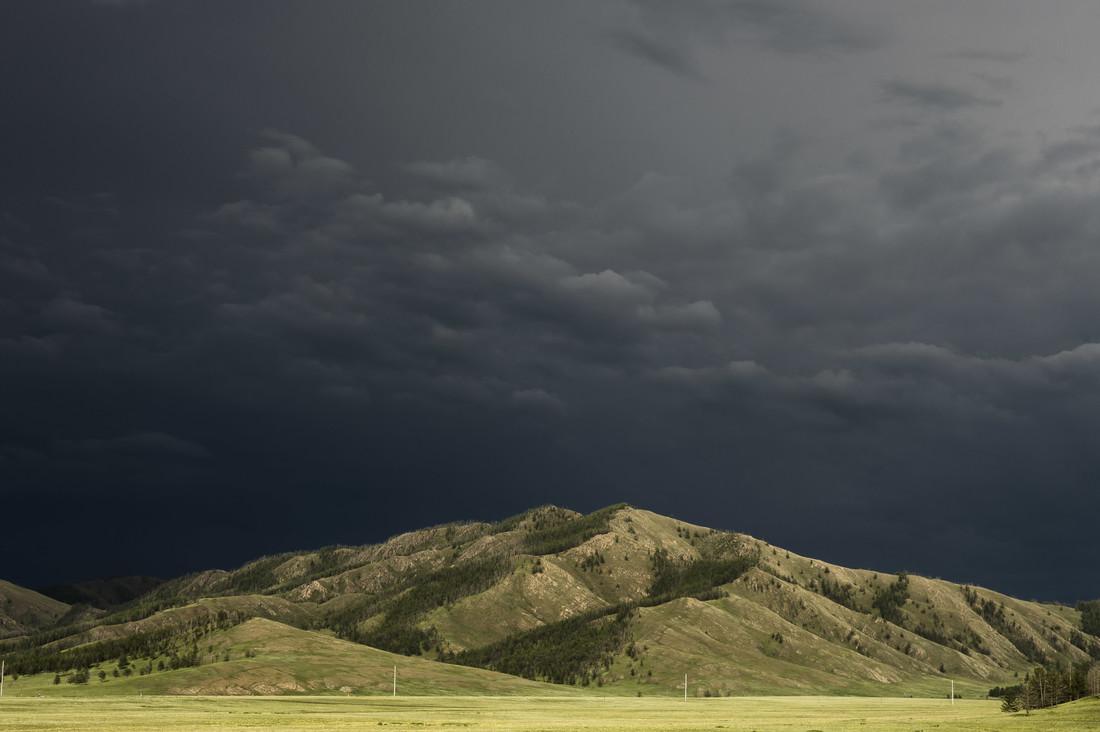 Dark Sky over Mongolian Plains - fotokunst von Schoo Flemming