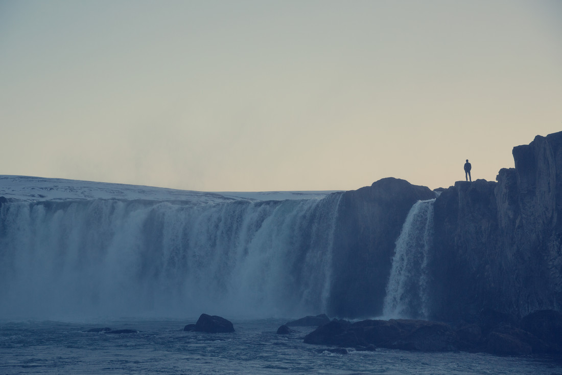 Human and waterfall - Godafoss - Fineart photography by Franz Sussbauer