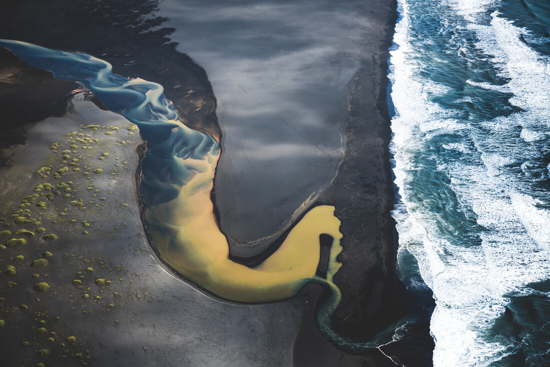 Colored river heading into the ocean in Iceland 2 - Fineart photography by Roman Königshofer