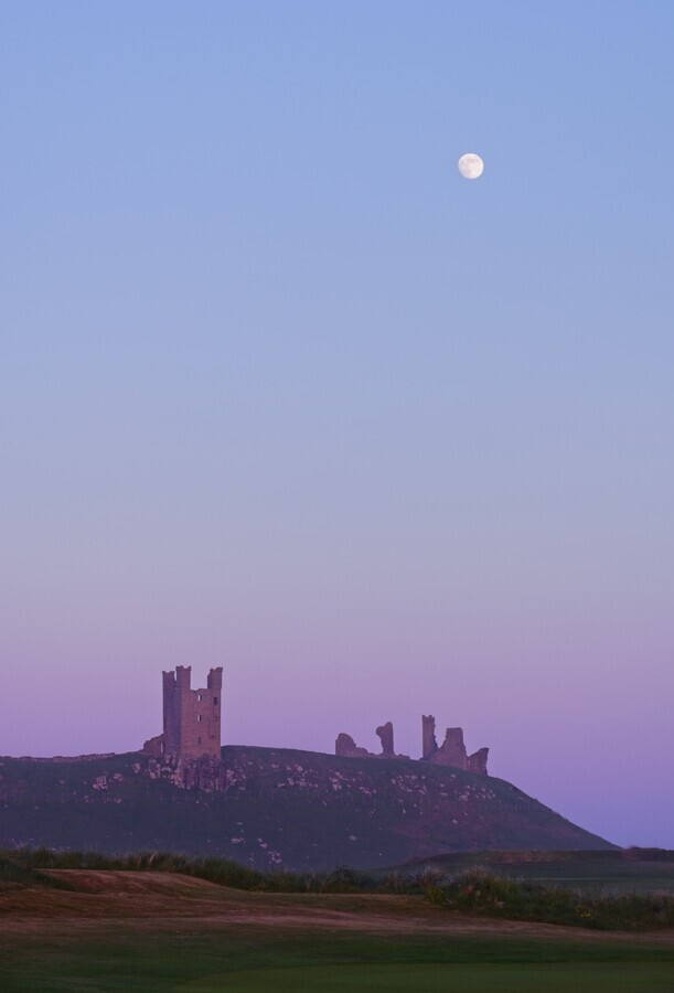 Moon over Dunstanburgh Castle - Fineart photography by Alex Wesche