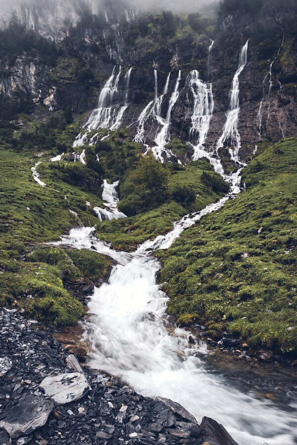 Waterfall in the Alps - Fineart photography by Alex Wesche