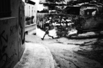 Nasos Zovoilis, A young boy running (Greece, Europe)