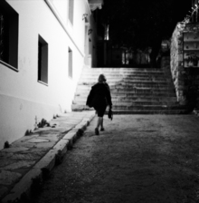 Nasos Zovoilis, A woman walking in the dark (Griechenland, Europa)