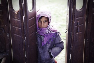 Rada Akbar, Girl stands outside of the ruined bus (Afghanistan, Asia)