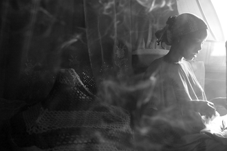 Christina Feldt, Young Afar woman in her house in Northern Ethiopia. (Ethiopia, Africa)