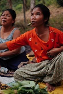 Jim Delcid, Woman Smoking at a Market In Laos (Laos, Asia)