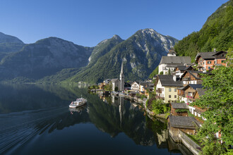 Franz Sussbauer, Hallstatt with clear blue sky and boat (Austria, Europe)