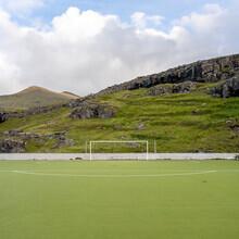 Franz Sussbauer, Artificial grass, swing and mountain (Faroe Islands, Europe)
