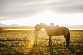 Leander Nardin, young woman and her horse at sunset (Kyrgyzstan, Asia)